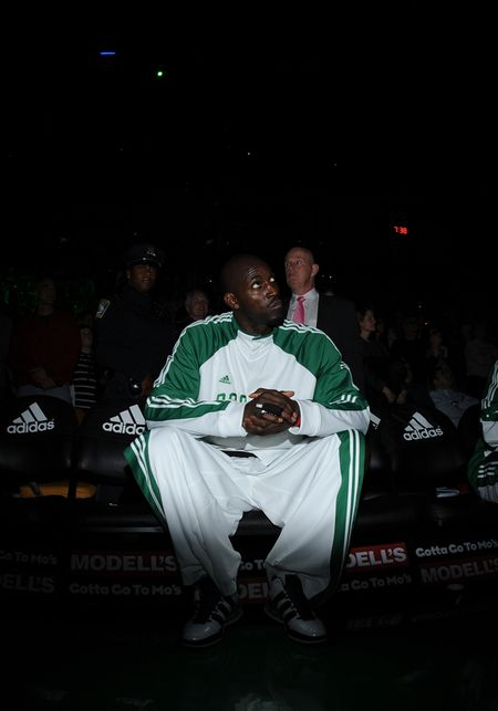 Kg sitting on bench
