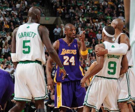 Kobe Bryant points a finger at Rajon Rondo