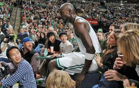 KG sits on fan's lap