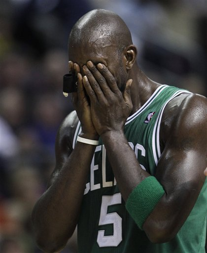 Kg hands over face
