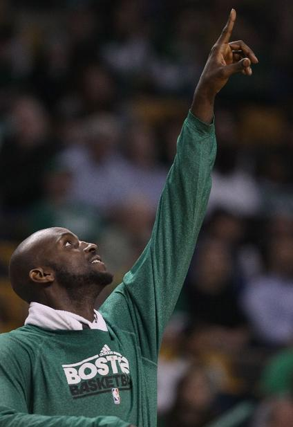 KG pointing up
