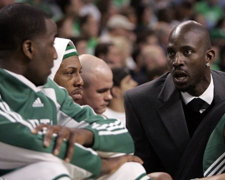 Kg in a suit talking to perk