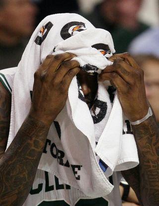 Shaq peeking from towel