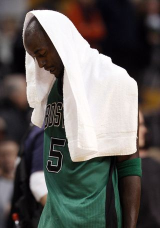Kevin garnett with a towel over his head