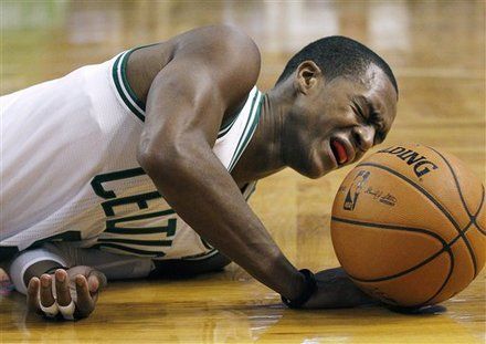 Rajon rondo grimacing on the floor