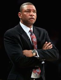 Doc rivers arms crossed on the sidelines