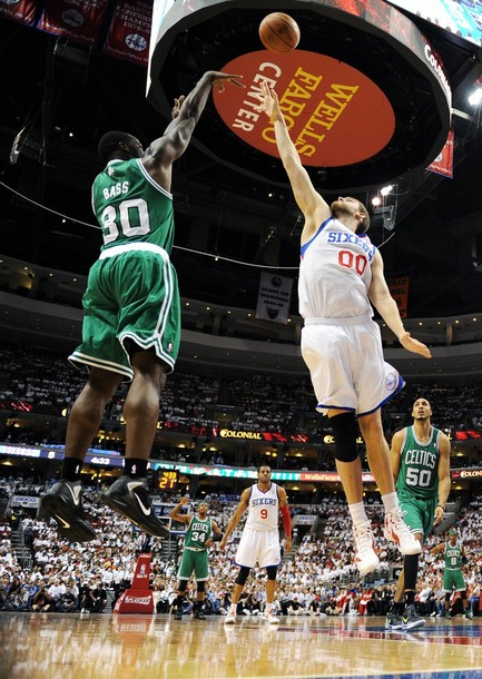 Brandon bass shoots over spencer hawes in game 4